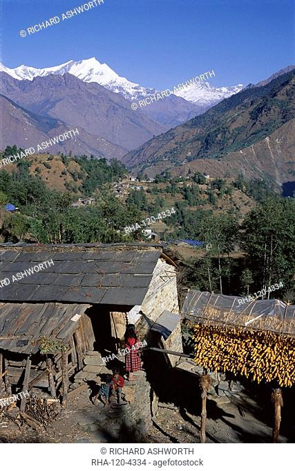 Corn hanging to dry outside village house, Sikha village, and view looking north between Tatopani and Ghorepani on the Jomsom Jomson Trek, north of Pokhara