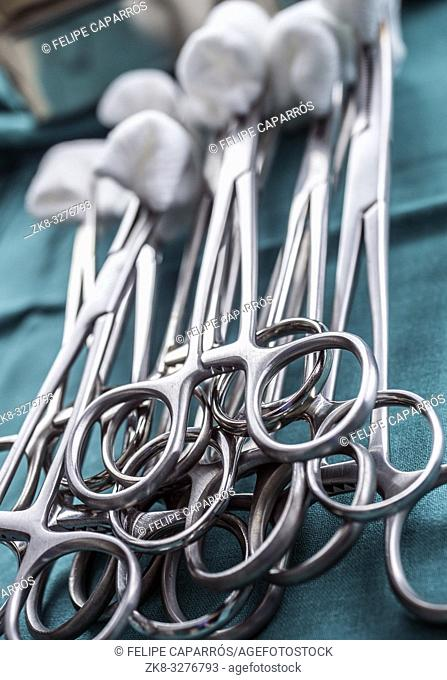Scissors surgical with torundas on a tray metal in an operating theater, conceptual image