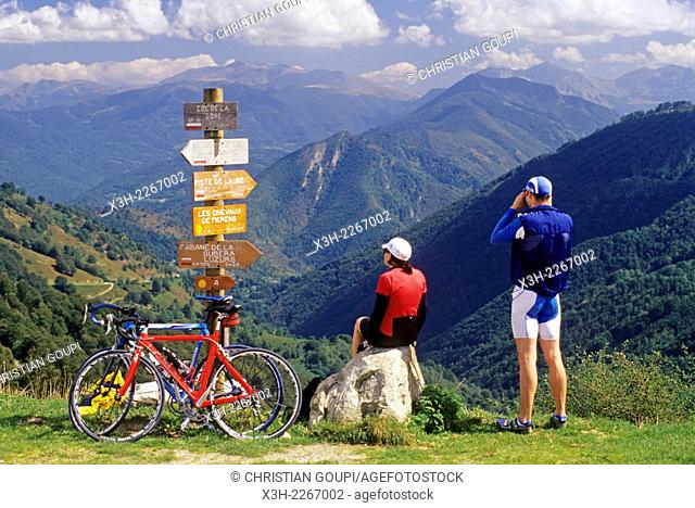 couple of cyclists at Col de la Core, mountain pass in Couserans province, Ariege department, Midi-Pyrenees region, France, Europe