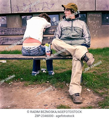 Girl and boy on a wooden bench, Czech Republic