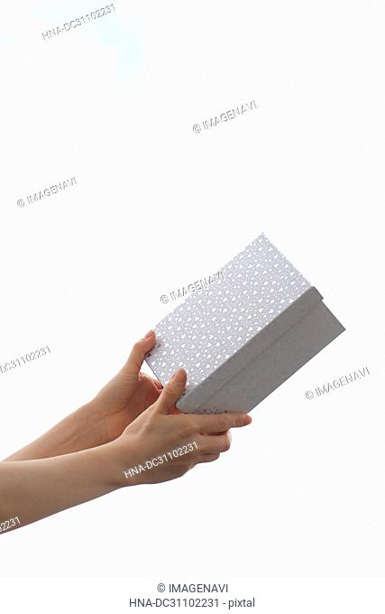 Woman Hand Holding Gift Box