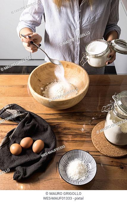 Woman preparing dough at home