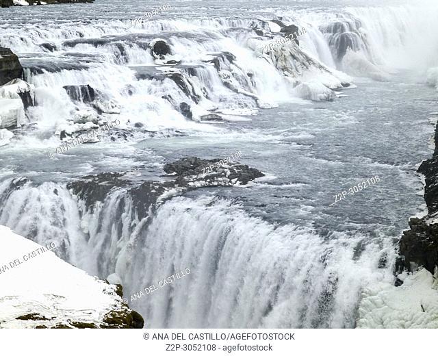 Amazing Icelandic winter landscape of majestic waterfall of frozen Gullfoss