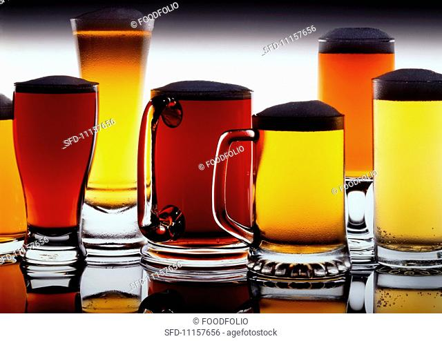 An assortment of (full) beer glasses and tankards