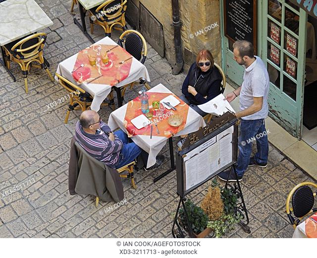 couple at a table in an outdoor restaurant, Sarlat-la-Caneda, Dordogne Department, Nouvelle-Aquitaine, France