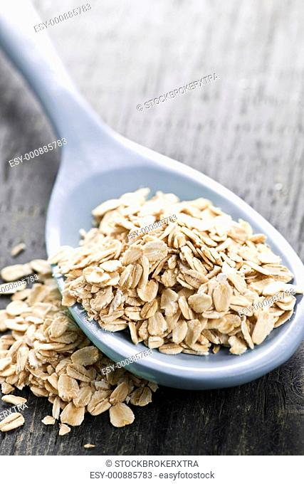 Nutritious rolled oats heaped on a spoon