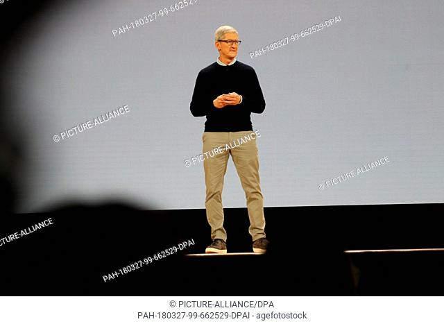 27 March 2018, USA, Chicago:Tim Cook, CEO of Apple, presenting an improved version of the ipad tablet in the assembly hall of the Lane Tech College Prep High...