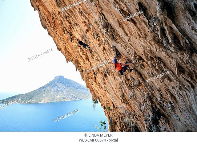 Greece, Kalymnos, two climbers in rock wall
