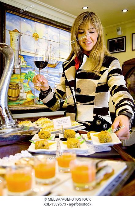 Woman tasting pintxos  Pamplona  Navarra  Spain