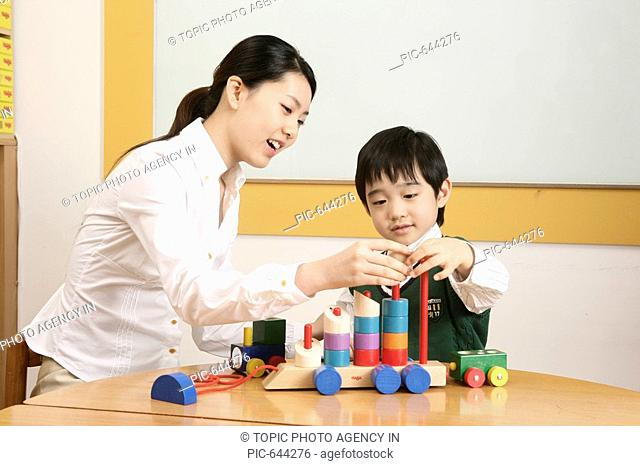Korean Boy Playing and Learing in the Kindergarten