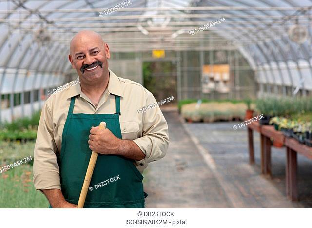 Mature man working in garden centre, portrait