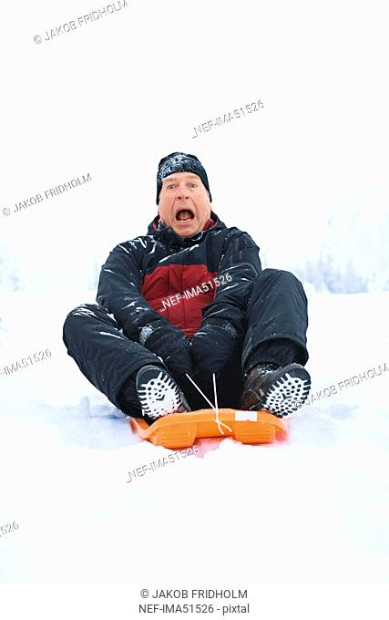 A man on a little sledge, Sweden