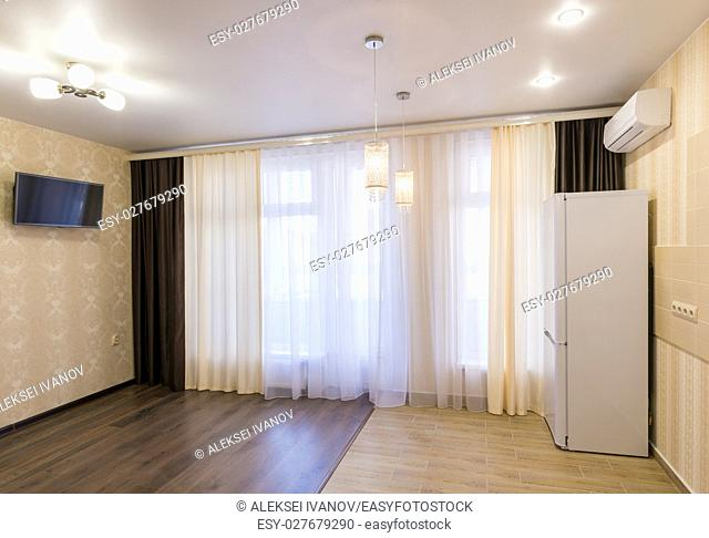 The interior of a small room with kitchen, renovated, unfurnished