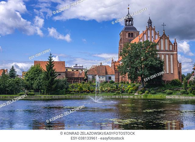 Gothic Church of Saint Anne and Saint Stephen over so called Prison Pond on Pisa River in Barczewo town, Warmian-Masurian Voivodeship of Poland