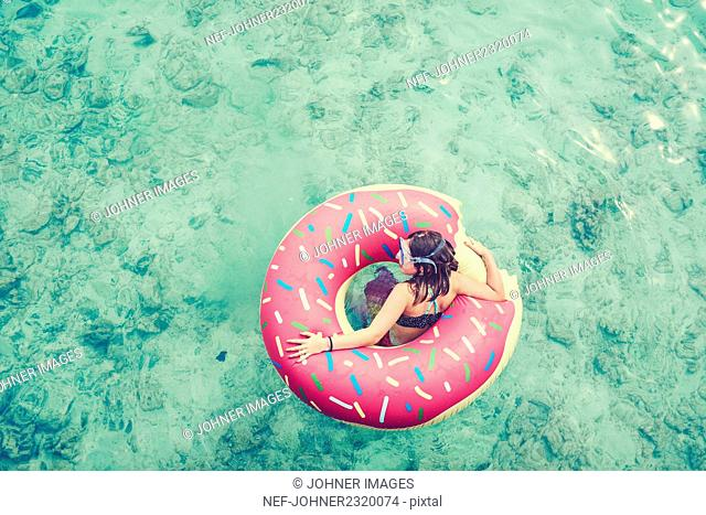 Girl swimming on inflatable ring