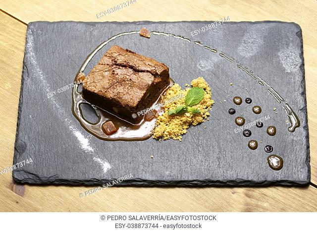 Chocolate brownie with cereals and mint