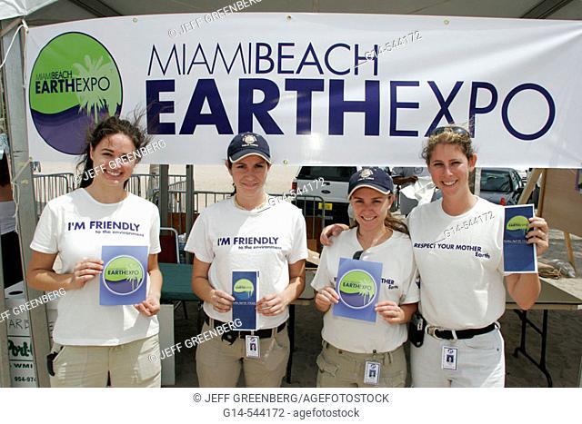 Female city employees, brochures, information. Earth Day Expo. Lummus Park. Miami Beach. Florida. USA