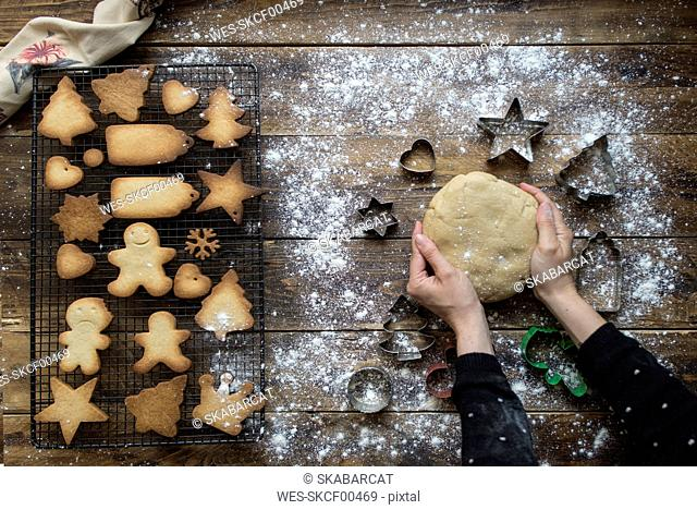 Woman's hands kneading dough for gingerbread cookies