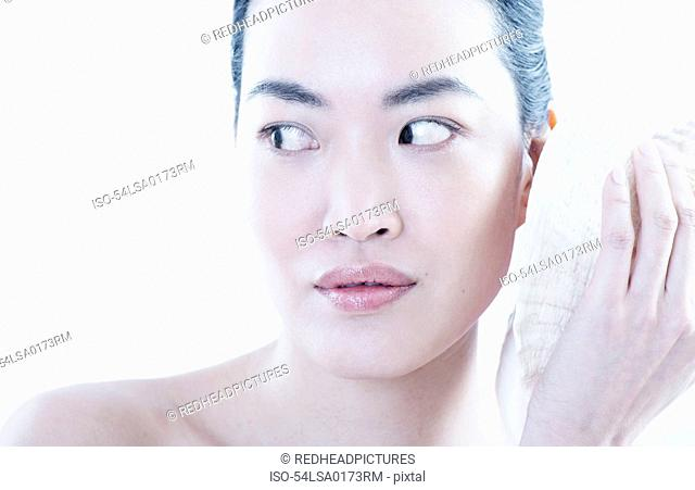 Woman applying ice pack to face