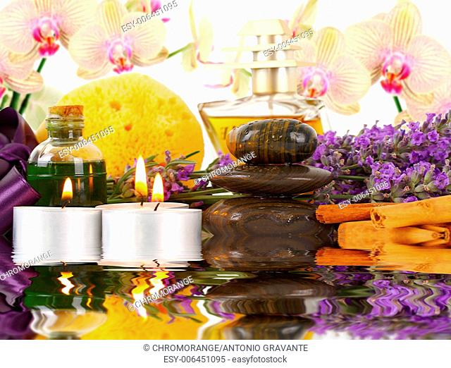 Accessories for spa with orchids, lavender, stones, sponge, candles and cinnamon