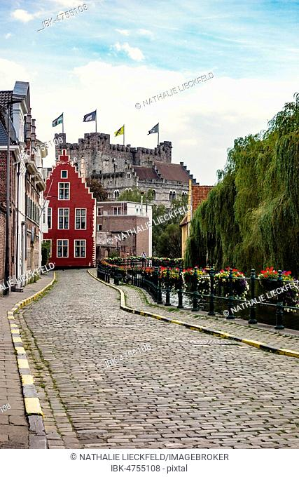 Road along the River Leie with a view of Gravensteen Castle, Augustijnenkaai, Ghent, Belgium