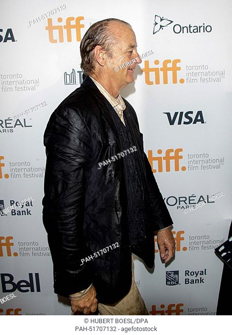 """US actor Bill Murray arrives in the pouring rain at the premiere of """"""""St. Vincent"""""""" during the 39th Toronto International Film Festival (TIFF) in Toronto"""