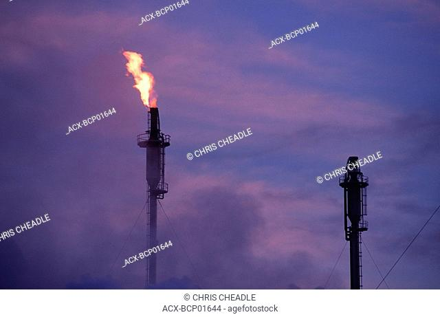 Flame from oil refinery at dusk, British Columbia, Canada