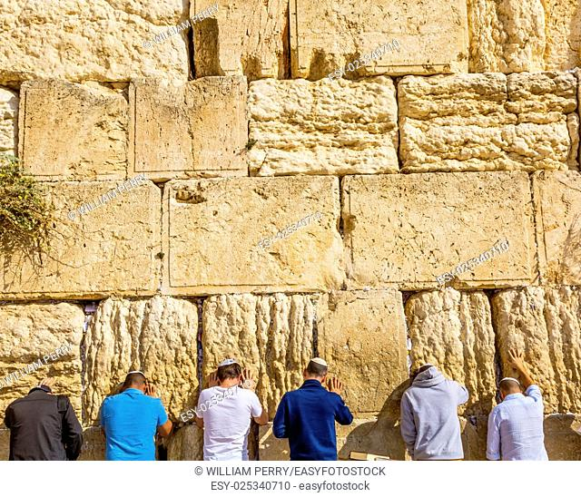 """Praying at the Western""""""""Wailing"""""""" Wall of Ancient Temple Jerusalem Israel. Western wall of the Ancient Jewish Temple built in 100BC by Herod the Great on the..."""