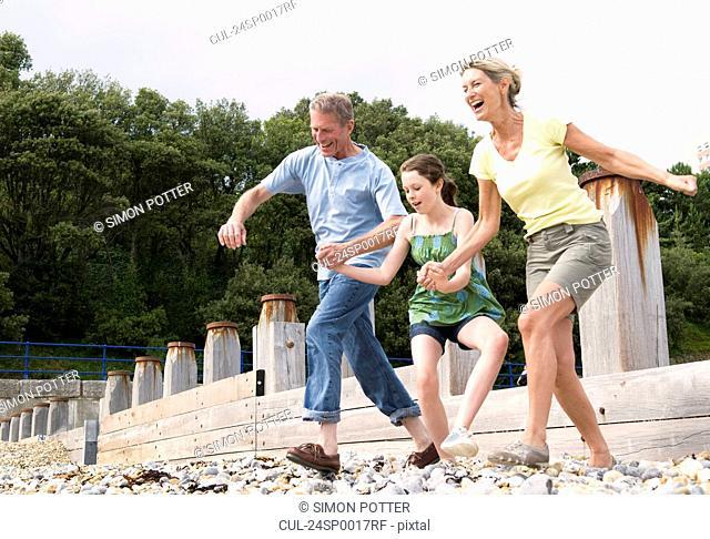 Seniors and granddaughter on beach