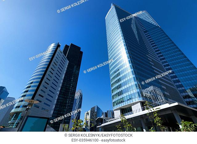 Modern business district in Paris and clear blue sky, France