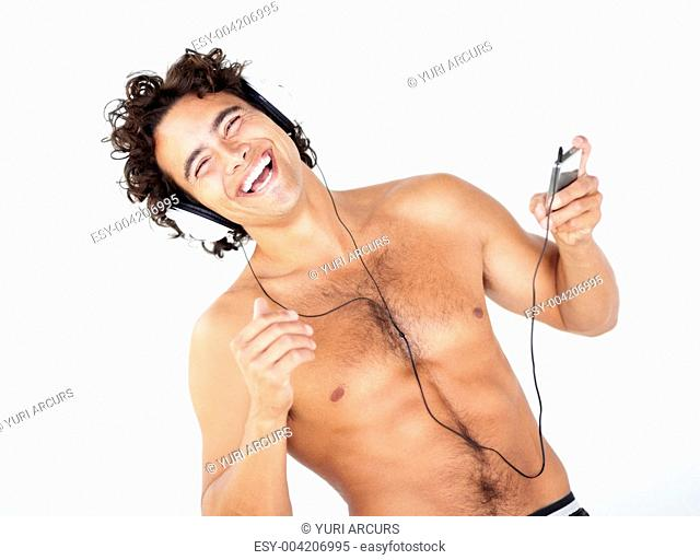 Portrait of a handsome young shirtless man listening to his mp3 player