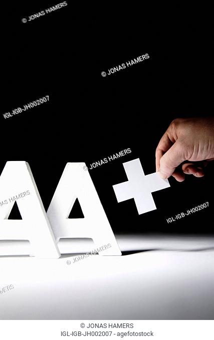 This illustration picture shows Triple 'A' Letters AAA with AA+ positive. The top three rating agencies -- Moody's, with Standard and Poor's and Fitch -- have...