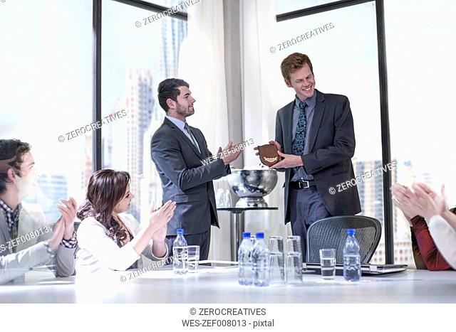 Successful business people celebrating awards in boardroom
