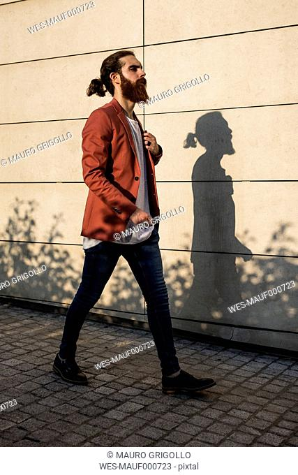 Fashionable young man walking in the city