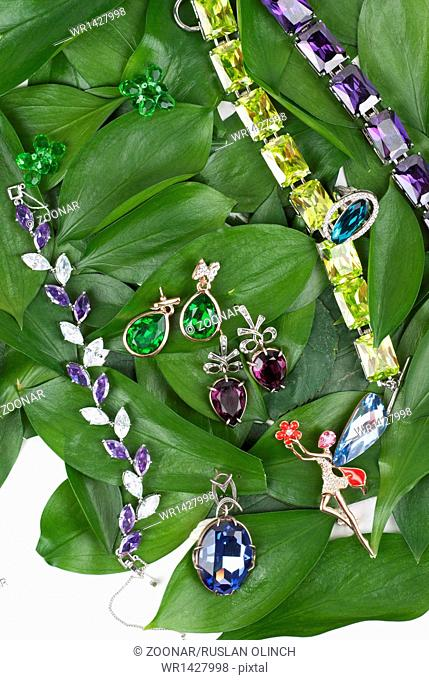 Jewelry at green leaves