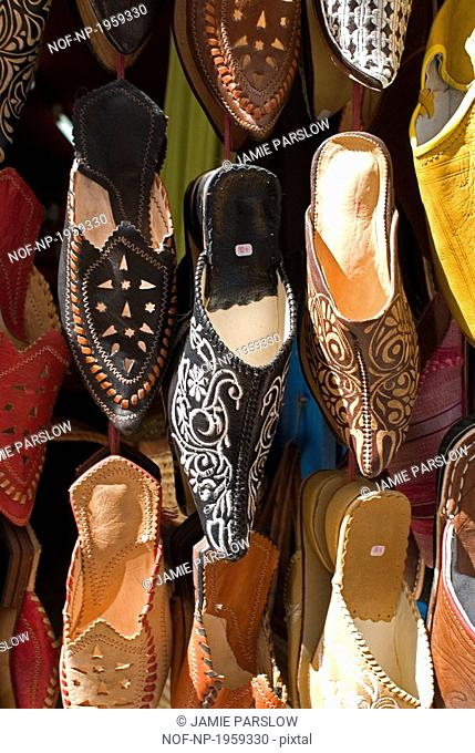Close-up of shoes hanging at a shoe store, Essaouira, Morocco