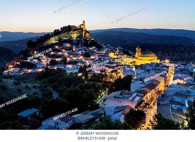 Aerial view of illuminated village in remote landscape, Montefrio, Andalusia, Spain