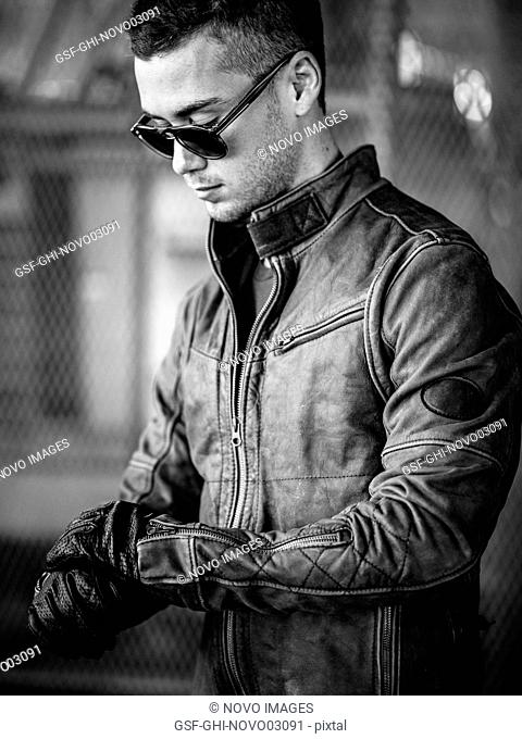 Portrait of Young Adult Man Wearing Sunglasses and Leather Jacket