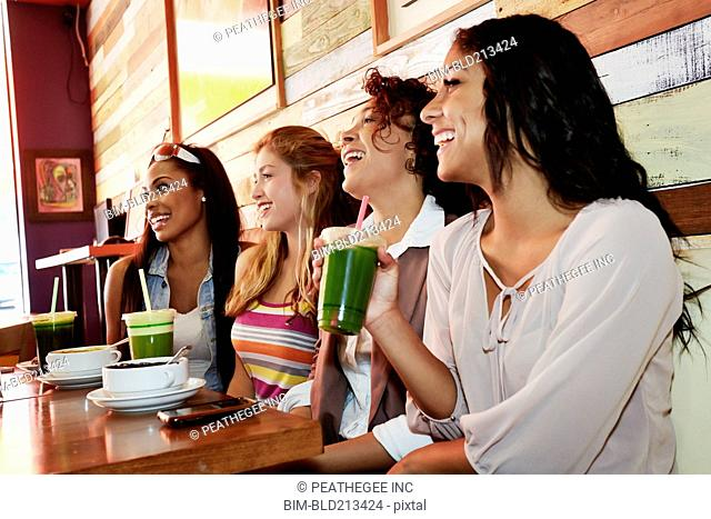 Women relaxing together in cafe