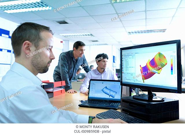 Designers designing components for casting in precision casting factory