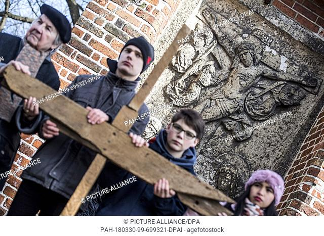 30 March 2018 Germany Luebeck People Participating In An Ecumenical Good Friday Procession Hold A Wooden Cross The Has Been