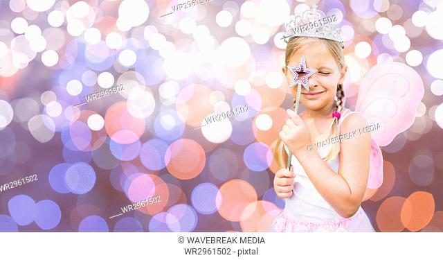 Girl in fairy costume over bokeh