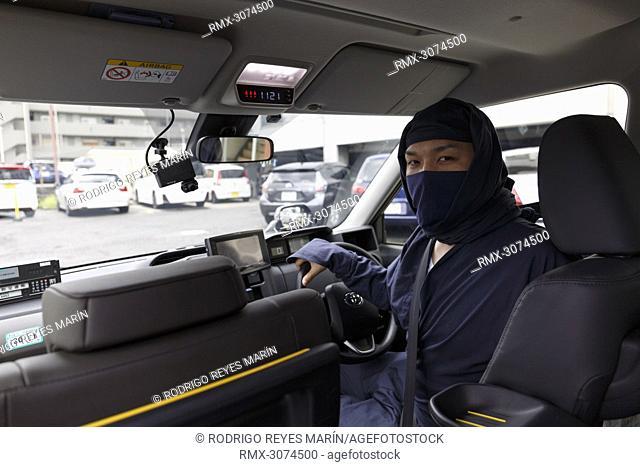 July 9, 2018, Yokohama, Japan - A Sanwa Koutsu Group taxi driver dressed in Ninja is seen inside his cab in Yokohama. Yokohama-based taxi provider Sanwa Koutsu...