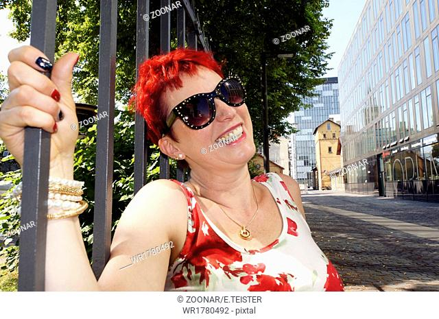 red-haired woman of about 50