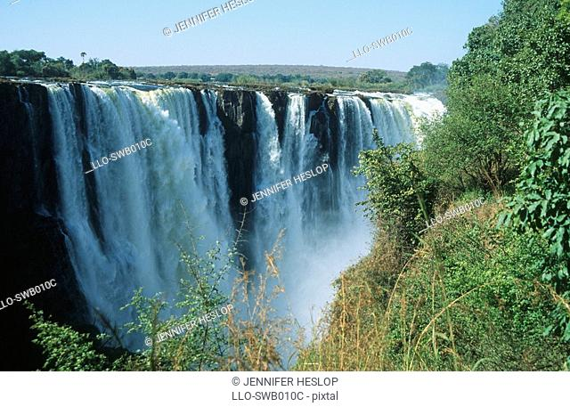 Scenic View of a Thundering Waterfall  Victoria Falls, Zimbabwe