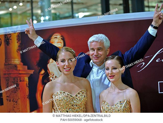 Chairman and Artistic Director of the SemperOperaball Hans-Joachim Frey poses with models Cecile (L)and Leontine who wear the debutant's dress for the...