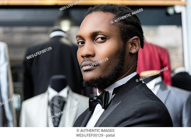 Portrait of a man wearing tuxedo in tailor shop