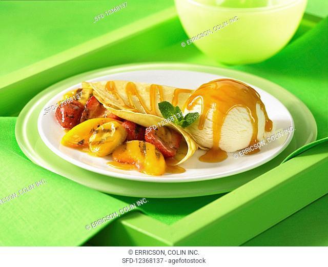 Fruit filled crepe ice cream butterscotch sauce
