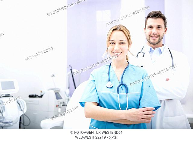 Portrait of two smiling doctors in medical practice