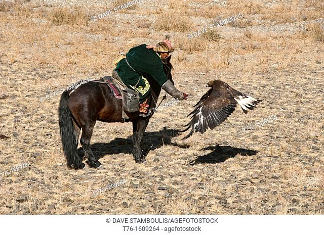 Kazakh eagle hunter and his golden eagle in the Altai Region of Bayan-Ölgii in Western Mongolia